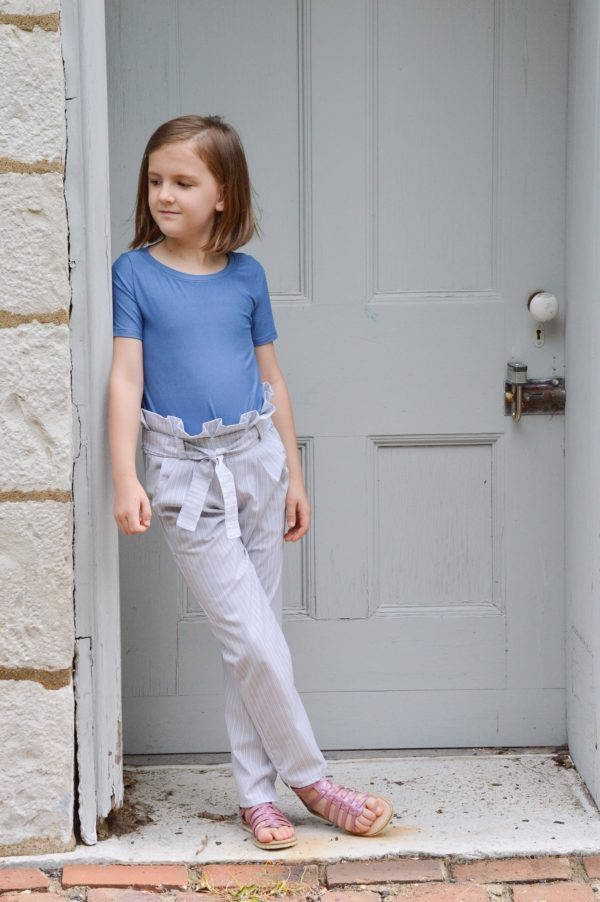 Piper is a super cute and comfy childrens paperbag pants sewing pattern. These trousers are slim fitting and practical and they have pockets!